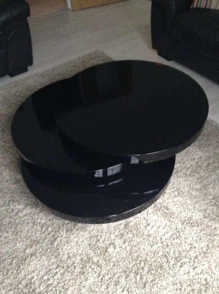 Black Round Gloss Swivel Coffee Table From Dwell