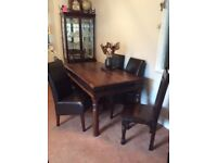 Large dark wood table and 6 chairs.