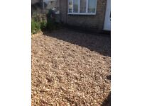 Two to three tons of decorative pebbles