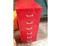 Red metal set of filing drawers