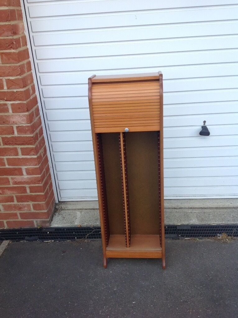 CD and DVD roll front Cabinet a honey coloured wooden cabinet to ...