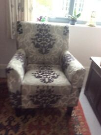 Sturdy, modern armchair.