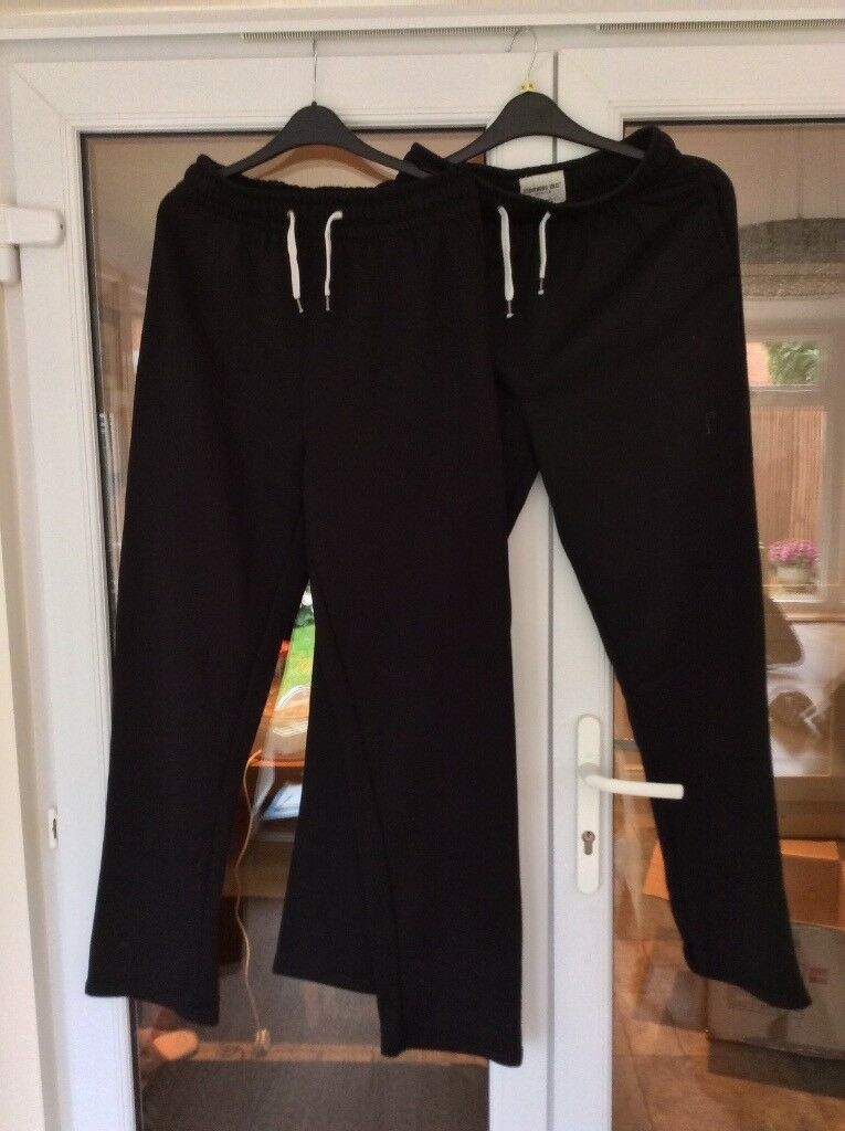 2 pairs black jog bottoms size medium