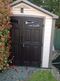8 x 9 ft keter plastic garden shed. Has double doors, window skylight and ventilation.