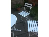 Metal, white, folding garden table and chairs. Excellent condition.