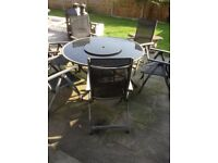Dark glass outside patio table and six chairs