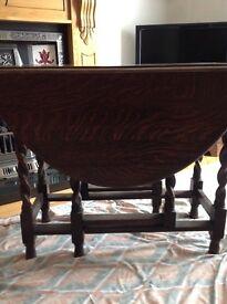A Solid Oak Barley Twist Gate Leg Table