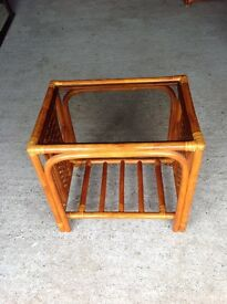 2 glass topped rattan tables ( 1 lamp table 1 coffee table)