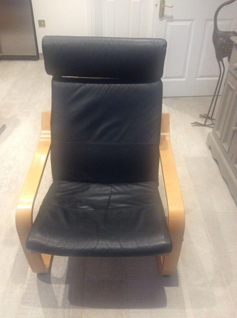 Two Ikea Poang black leather chairs with beech veneer and matching footstool. Good condition.