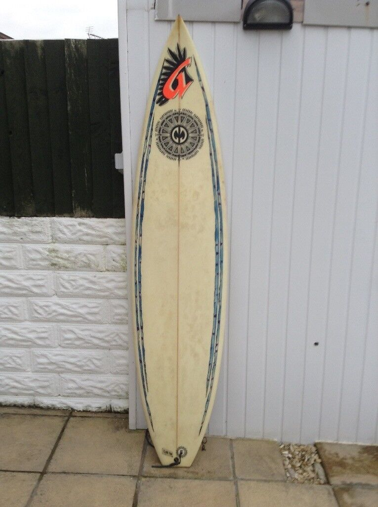Surf board by General surfboards,plus cover