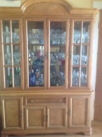 Light oak dresser with glass shelves and mirrored back and lights
