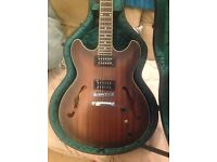 Ibanez Artcore electric guitar with hard case, amp, and accessories