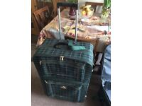 Two large suitcases for sale in good condition, can be pulled along .
