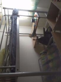 Super bunk bed with futon style pull out bed underneath along with desk £85 nearest offers