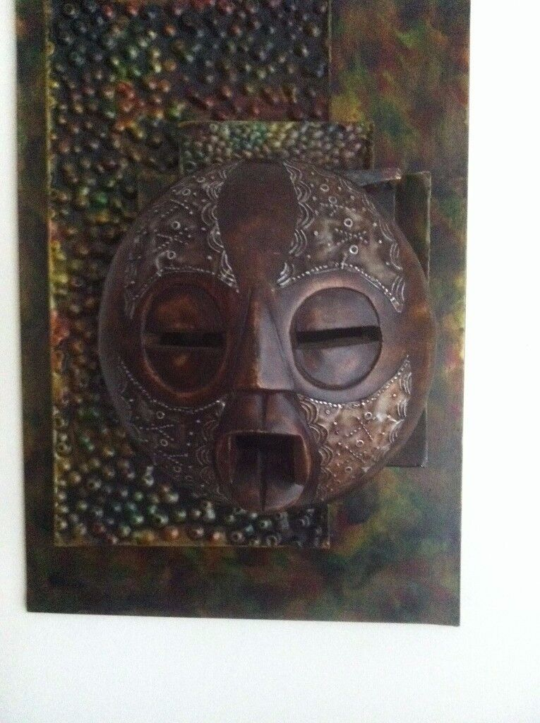 A wonderful wall hanging abstract metal mural