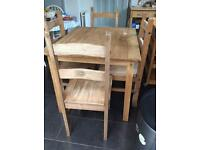Wooden Table with Four Chairs £20