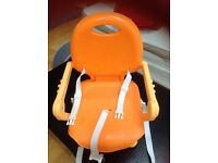 Baby/toddler booster seat for feeding. Can sit on normal chair. Excellent replacement for highchair