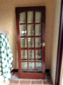 Range of solid, mahogany, varnished, hardwood doors and glass - pannelled doors.