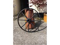 Chimney pot, terracotta plus cast iron wagon wheel. Wagon wheel sold,.