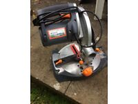 Bench mounted power mitre / chop saw.