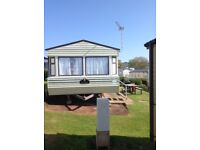 HOLIDAY STATIC CARAVAN FOR RENT JULY & AUGUST VERY GOOD PRICES AT DEVON CLIFFS EXMOUTH IN DEVON