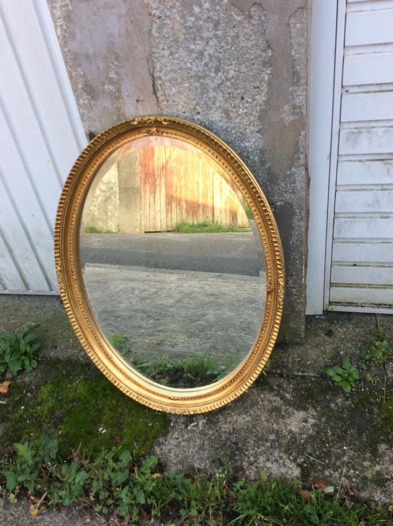 Gilt framed bevel edged oval mirror