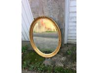 Gilt framed bevel edged oval mirror