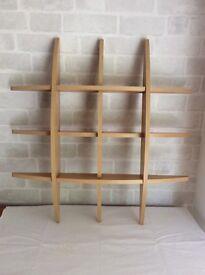 Hang on wall /display shelving unit. Pale wood colour.