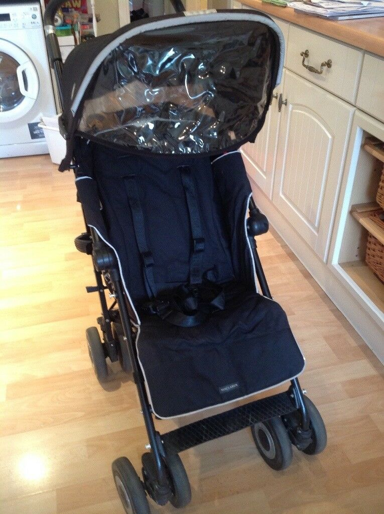McLaren XT buggy. In excellent condition. Very light use. With footmuff and head support unopened.