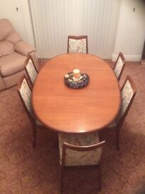 Dining Table with six chairs to seat ten.