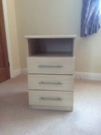 Bedside cabinet. Excellent condition, three drawers and handy storage shelf