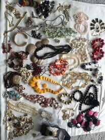 Large quantity 1970's-1980's retro costume jewellery; over 23 necklaces, bracelets, earrings