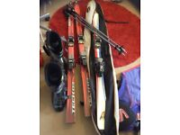 two sets of skis and poles one pair of boots size 9 plus carry bags