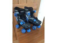 Blue adjustable roller skates. Size 12 -1