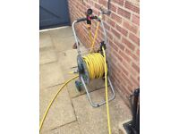 Garden reels and two hose pipes