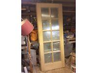 "Two oak engineered beveled glazed doors 78""high 30""wide"
