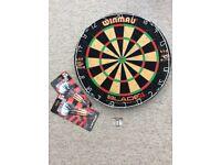 Winmau Dart board, 2 packs of darts and fixings.