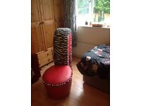 Stiletto shaped faux red leather and zebra print chair
