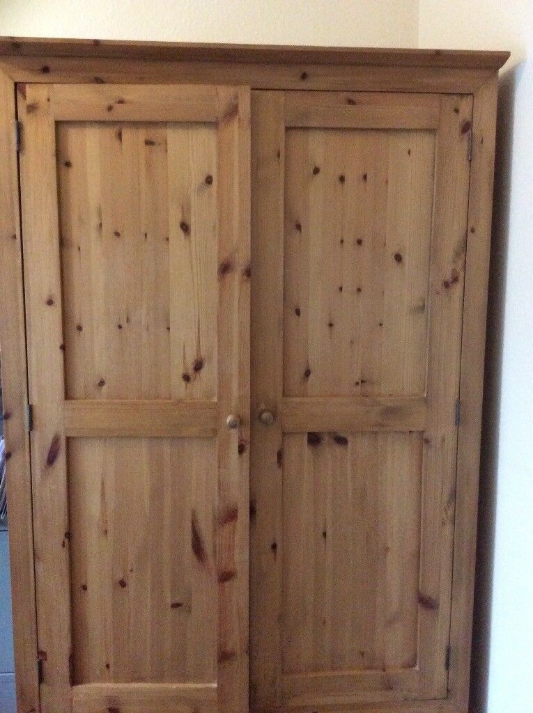 Solid wood wardrobe with two under drawers, good condition