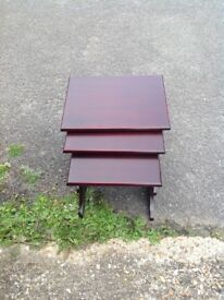 Mahogany nest of x3 tables in good condition for sale.