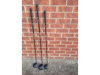 Golf bag and several golf clubs