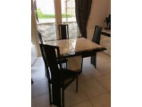 Marble dining table, leather effect chairs and marble sideboard