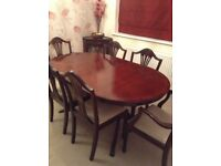Mahogany Dining Table and six Chairs including two carvers