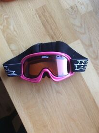 Pink female ski goggles with bag to keep them in