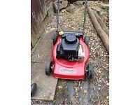 Mount field petrol lawn mower