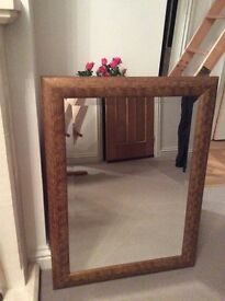 Mirror with bronze coloured frame