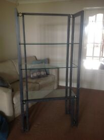 Metal/glass shelving unit and matching 3 stacking tables. Immaculate condition.