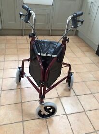 Brand new 3 wheeler walking aid with brakes, bag and basket. Never been used.