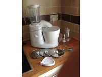 Unused Kenwood Cuisine food processor with attachments