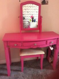 Pink dressing and stool